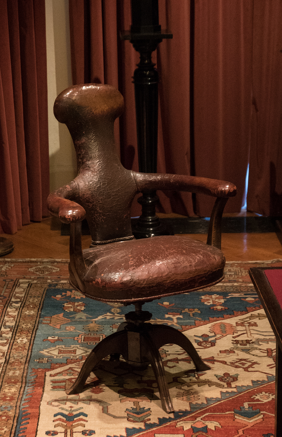 Richmond Nicholas Photography. Freud's study in London - his remarkable chair made to his own design.