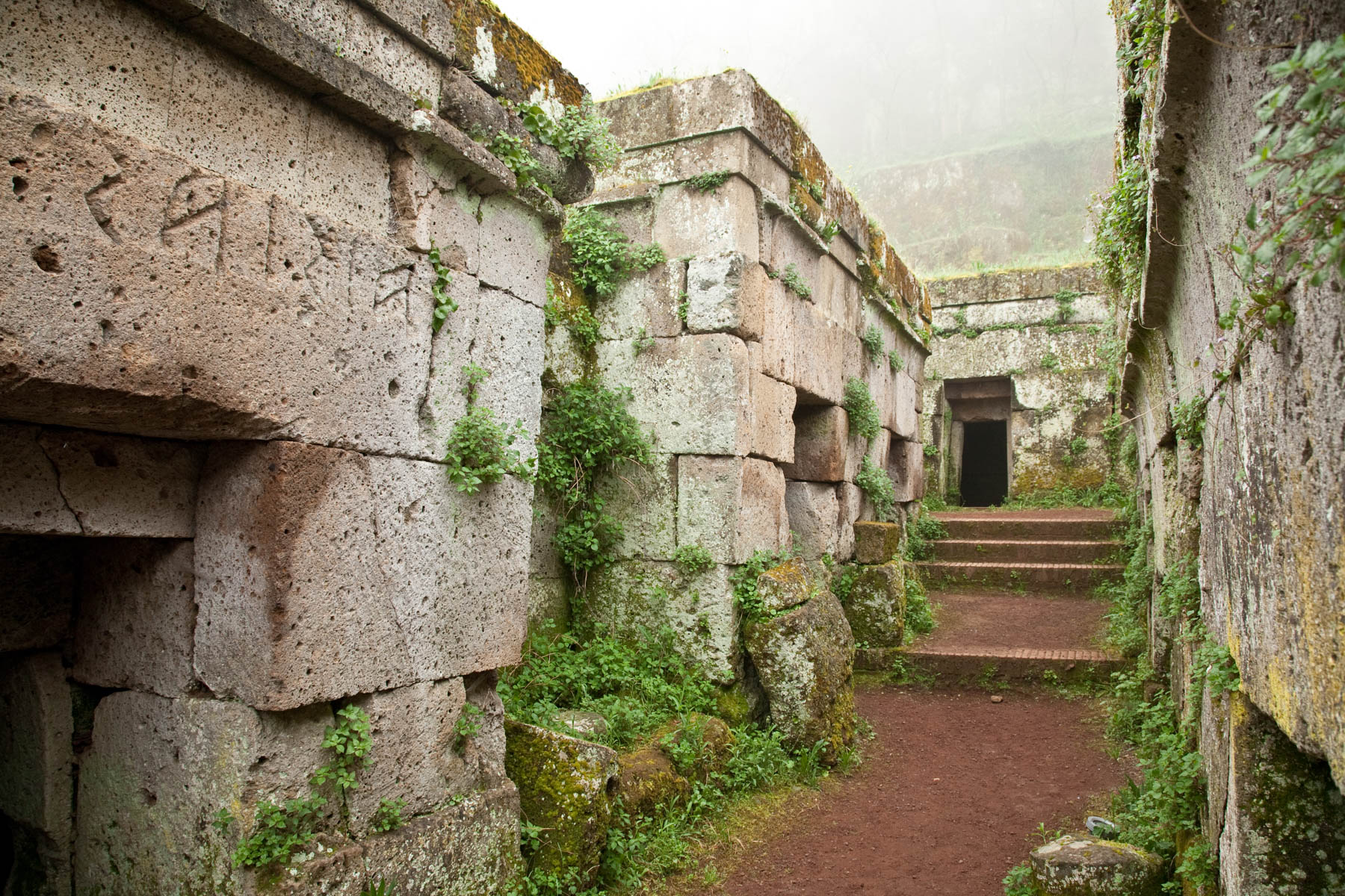 The Etruscan Cemetery, the tombs built like wooden houses on a street, the names in etruscan script are above