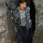 well-equipped female photographer