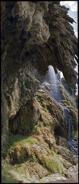 Vulci stalactite cliff and waterfall