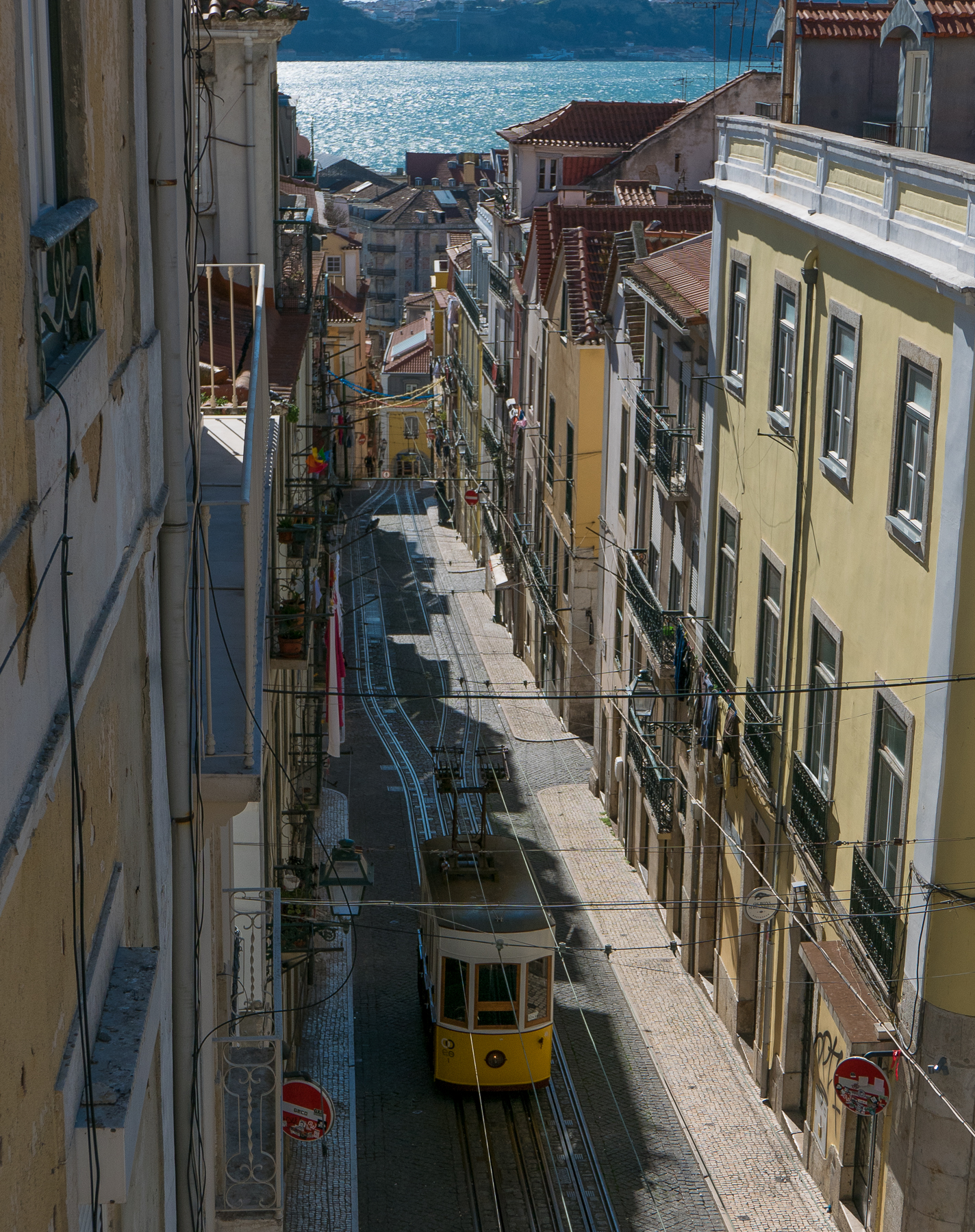Photo workshops in Lisbon and the Algarve- tram in Lisbon, in Bica street, the sea in the distance.